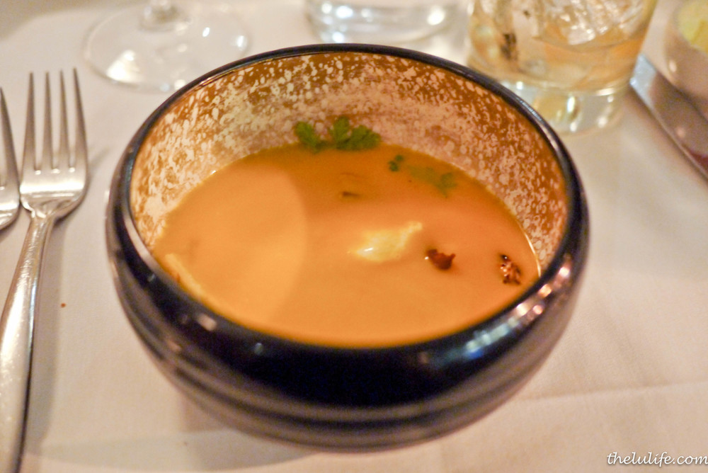 Blue hubbard squash soup over mascarpone mousse and toasted almonds