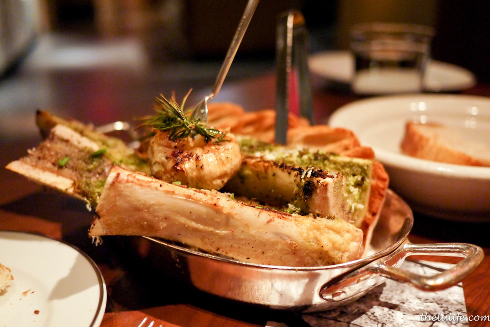 Wood oven-roasted bone marrow with horseradish butter, parsley crust
