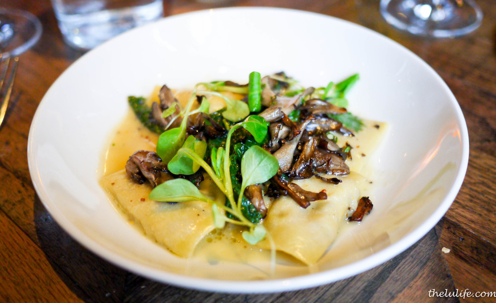 Mushroom agnolotti topped with crispy maitake mushrooms, mustard greens and whole grain mustard