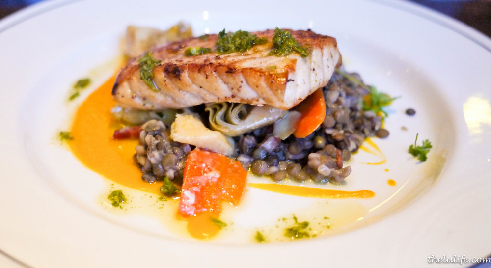 Seared sturgeon over lentils, bacon and artichoke barigoule