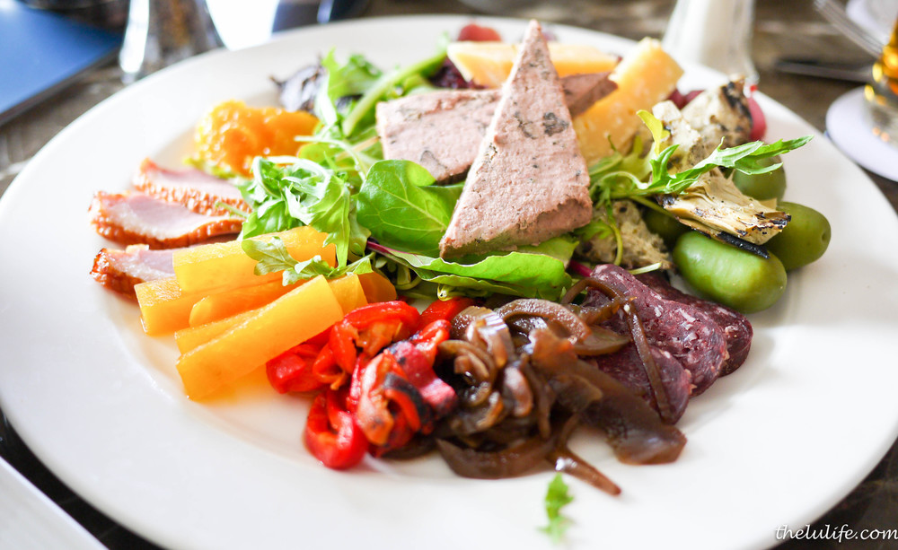 Rocky Mountain Antipasto Platter - locally air dried bison, smoked duck, venison salami, wild boar pate, grilled artichokes, pickled beets, roasted peppers, olives, Grizzly Gouda