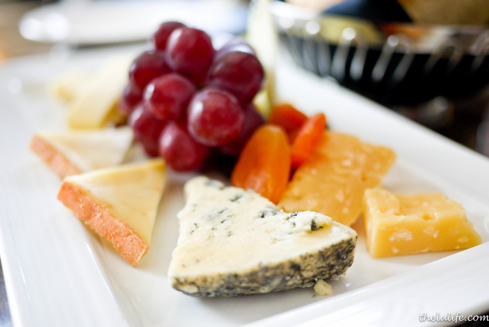 Canadian Cheese Slate - Oka classique (Quebec), Blue Benedictin (Quebec), Nostrala (BC), Le Cendrillan (Quebec), Grizzly Gouda (Alberta), black mission fig compote, candied pecans, dried apricots, grapes