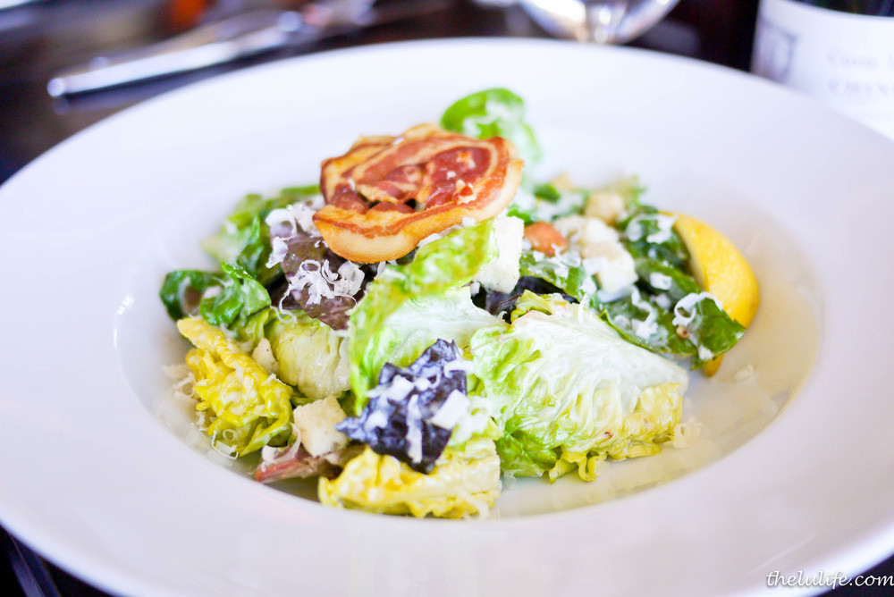 Caesar salad - baby red and green romaine, herb croutons, pancetta crisp, caesar dressing