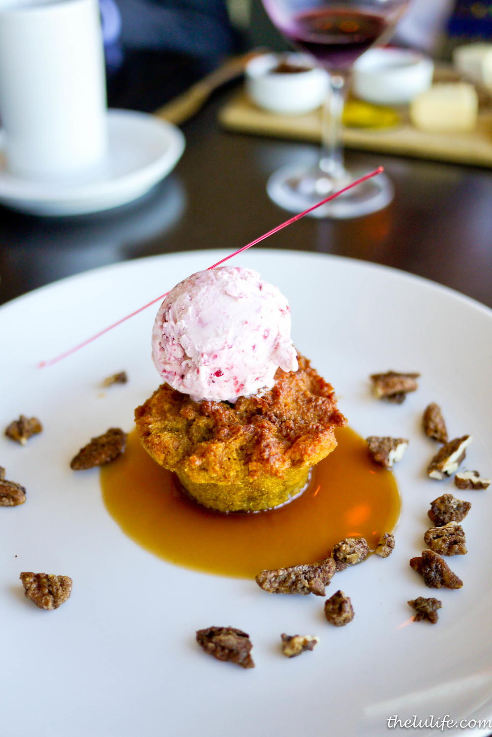 Pumpkin bread pudding with cranberry gelato, whiskey caramel, sugar tuile, candied pecans