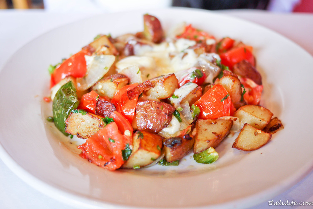 Tex-Mex Potatoes - potatoes, onions, tomatoes, jalapenos, green peppers, red peppers and cilantro topped with chihuahua cheese eggs