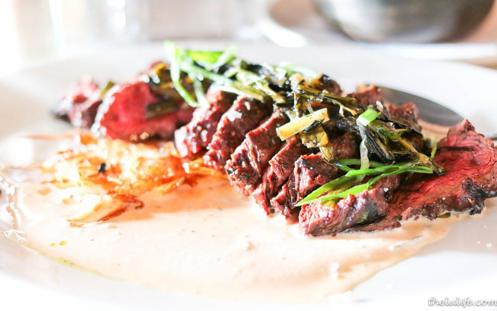 Grilled Slagel Farm Steak with potato pancake, sour cream and spring onion relish