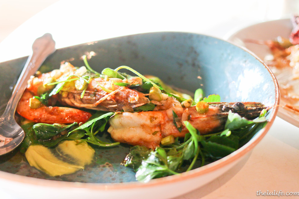 Whole roasted shrimp with spring onion, green garlic and asparagus