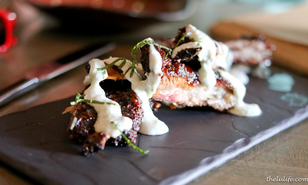 Smoked lamb ribs with tamarind BBQ sauce, yogurt and mint