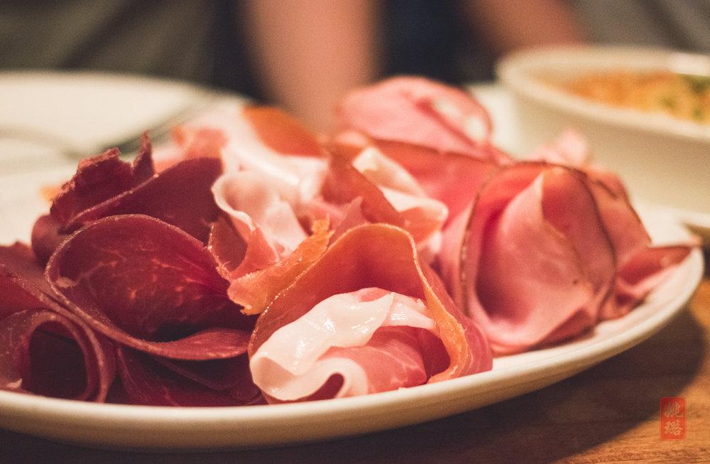 The meats in the Complete Suisse platter: Viande séchée, prosciutto de Parma, jambon de Paris, Saucisson sec