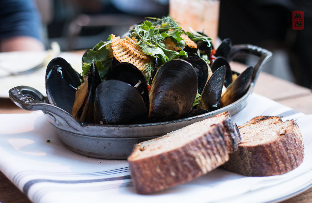 Mediterranean mussels with potato, chorizo, and pickled peppers