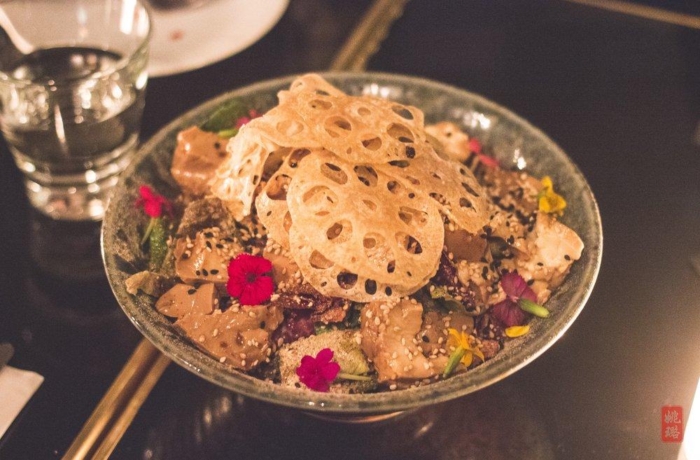 Cold tofu salad - market greens, soft tofu, lotus root chips, 'shroom powder