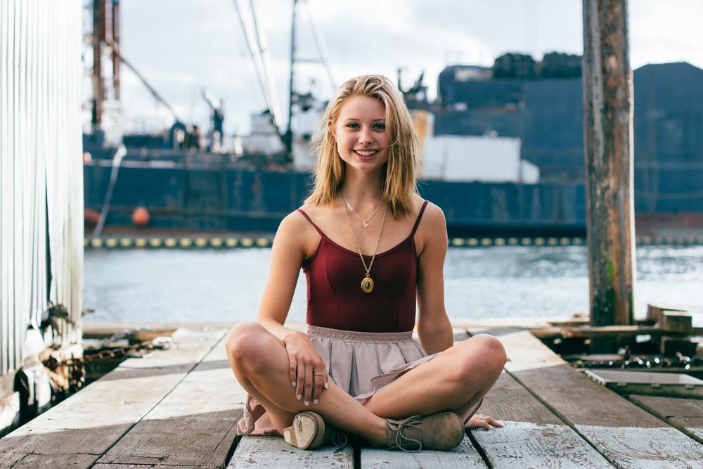 Woman cross legged on pier