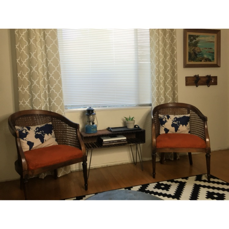 Now I have a great little table in the center of these Cane Chairs I picked up not to long ago. Oh and if you must have my  World Pillow Covers  you can pick them up for next to nothing on  Amazon .