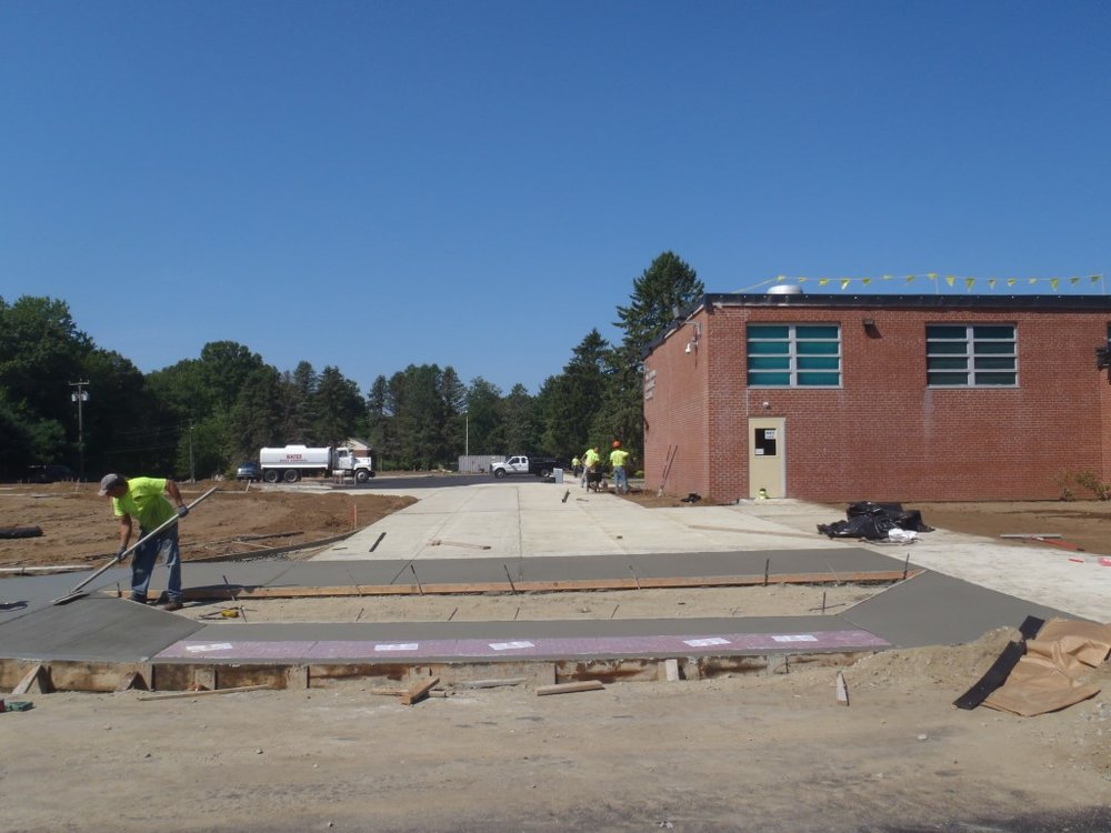 Plaza connecting bus drop-off to student drop-off and main entrance.