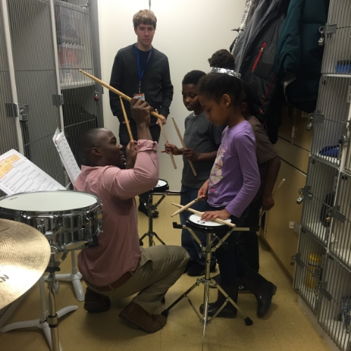 Percussionist Joshua Jones workng with students on snare drum technique at The People's Music School.