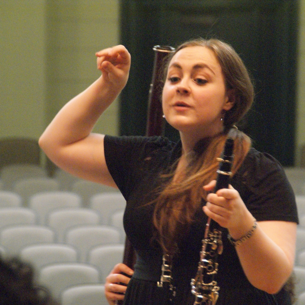 Director of Education Melissa Morales leading a breathing exercise for the woodwind and brass students at Morgan Park High School.