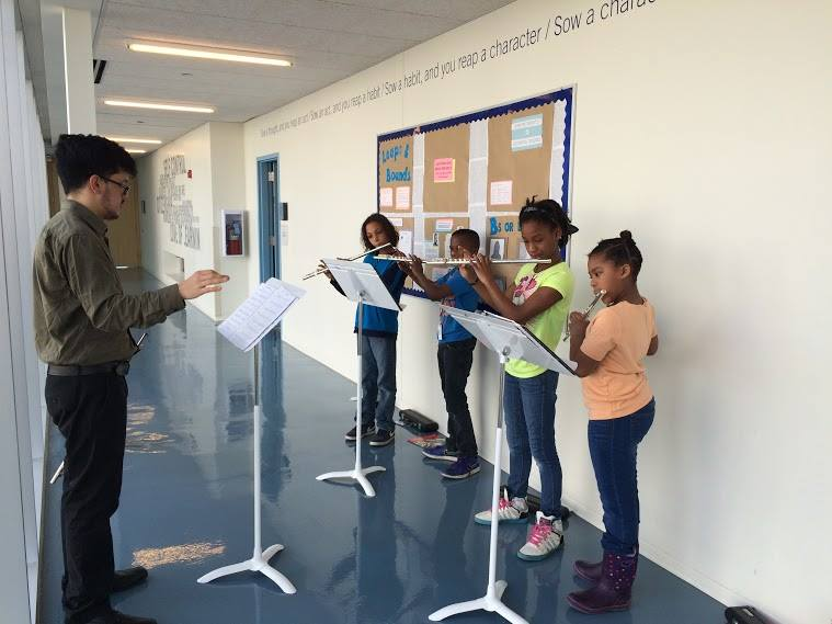 Flutist Ryan Zerna works with students at The People's Music School.