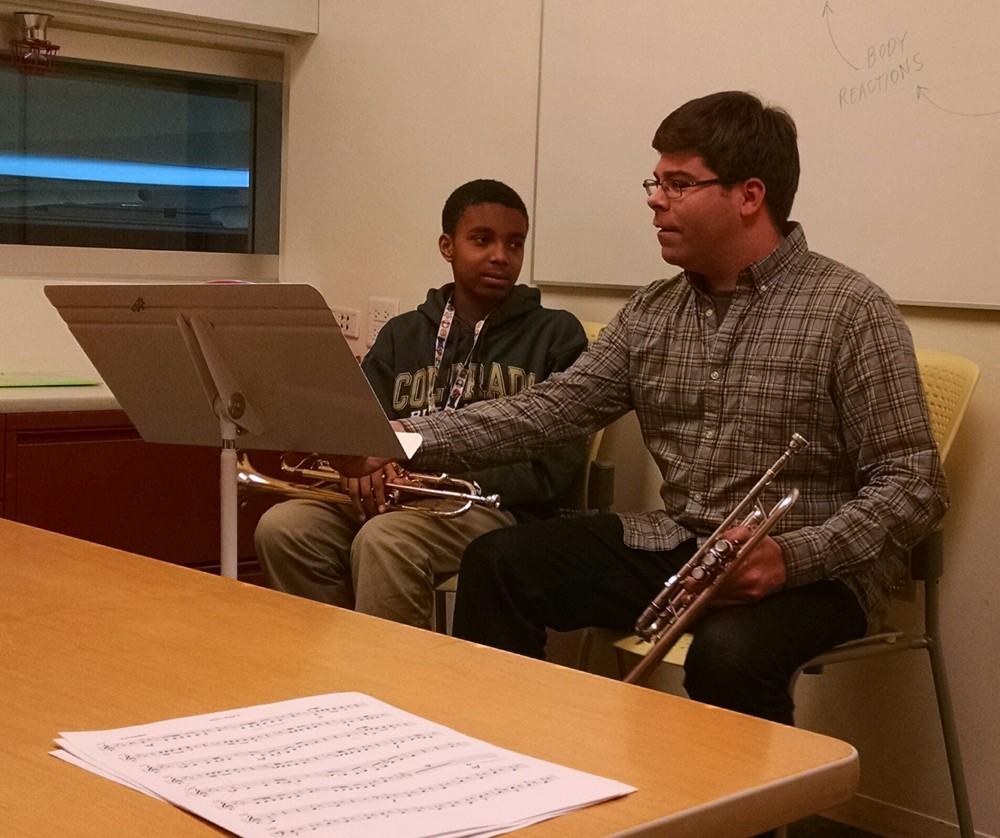 Trumpeter Gregory Strauss works with a student at The People's Music School.