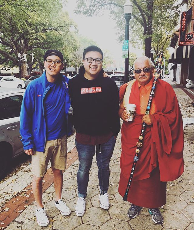 "Jordan Nguyen: ""This is one of the only pictures that I have with Huy. It was taken a little bit after I crossed while visiting him in Lakeland. This strange old man wearing robes and holding a staff that we'd never seen before came out of nowhere and stood to be a part of the photo, and without hesitation Huy invited him in and had a conversation about the man's day. He made it all seem so casual and nothing out of the ordinary. I didn't think too much about it then, but looking back, this really is a good example of the way Huy lived his life—all heart and with open arms. He turned this encounter into a teaching moment for me and it's given this picture so much more meaning."" #huyremember"
