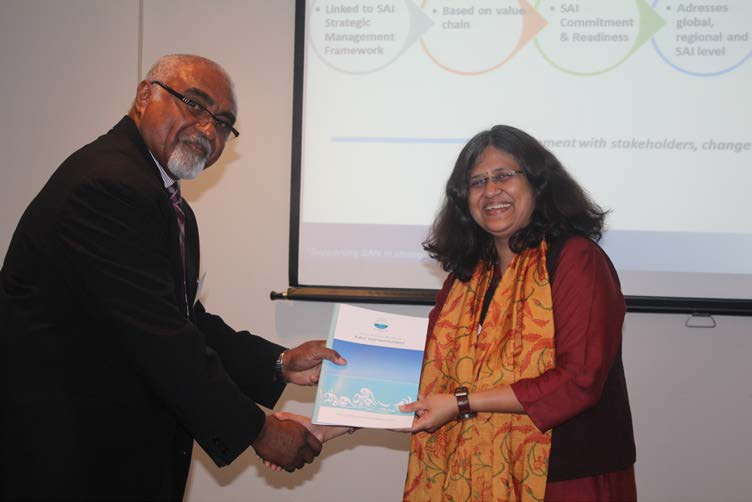 Launching of Regional Report – PASAI Advocate Mr Eroni Vatuloka handing over the regional report officially to IDI Ms Archana Shirsat Deputy Director General and Head of Capacity Development