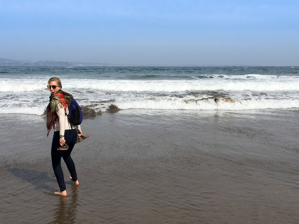 Erin getting wild on a Chilean beach.