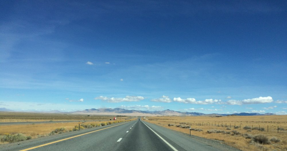 Blacktop and prairie as far as the eye can see in northern Nevada.