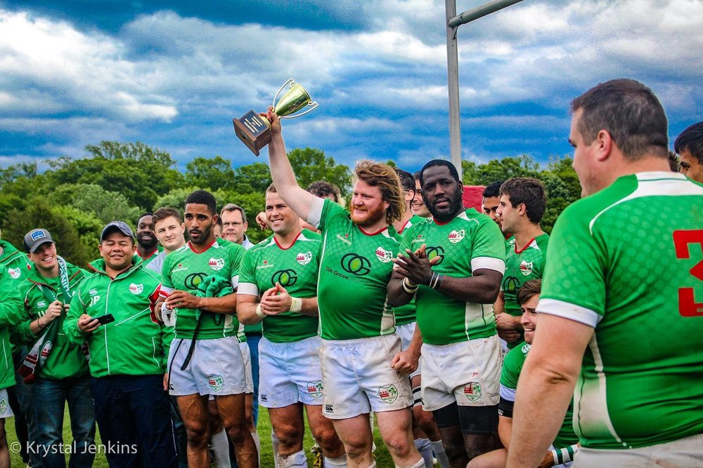 This photo of Bragan and the Irish moments after the MAC Championship trophy presentation will live on in WIRFC lore for generations to come. Photo credit: Krystal Jenkins
