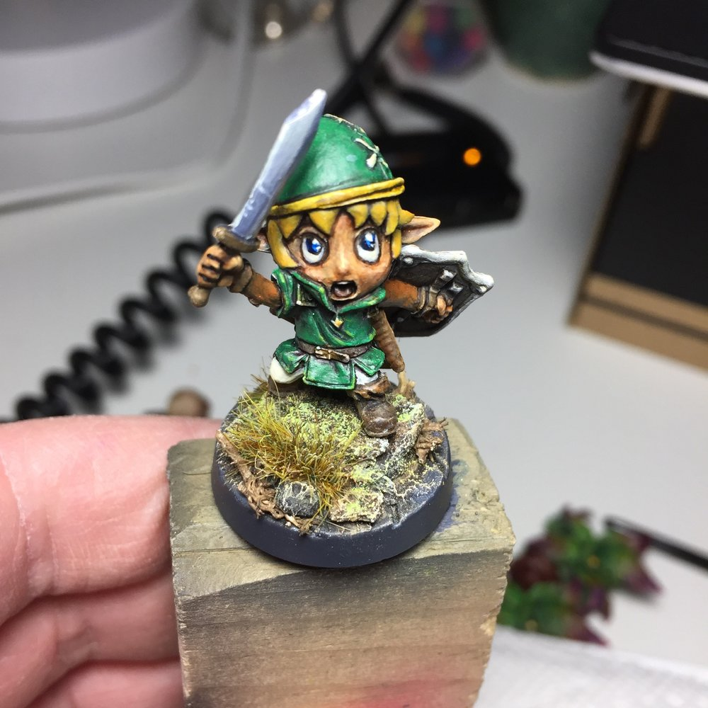 Inspired by the Link's Awakening remake announcement from this week, I painted the Deeproot Scout from Super Dungeon Explore in a Link's Awakening Inspired palette.