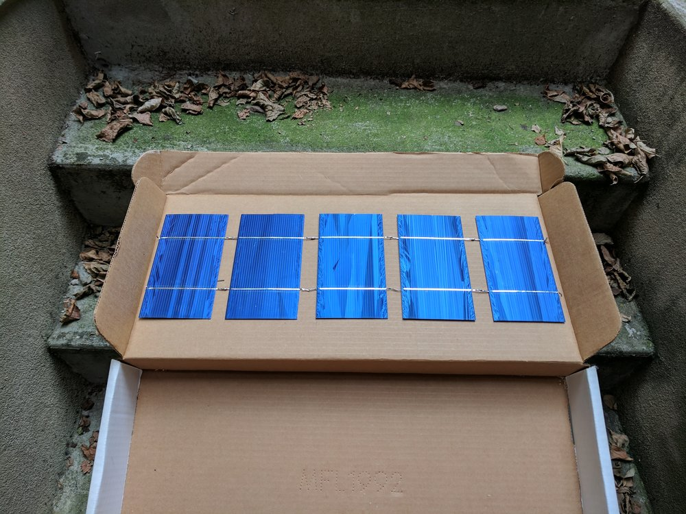 Solar box. Control voltage changed by opening and closing the box.