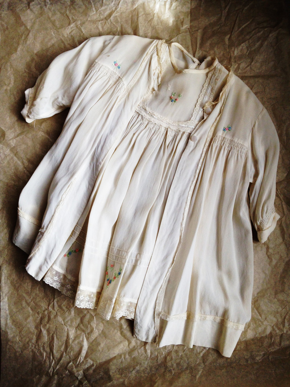 My christening 'gown' (as they were known then)- aged silk, hand smocking & rosebud trimmed. Definitely 'vintage'.