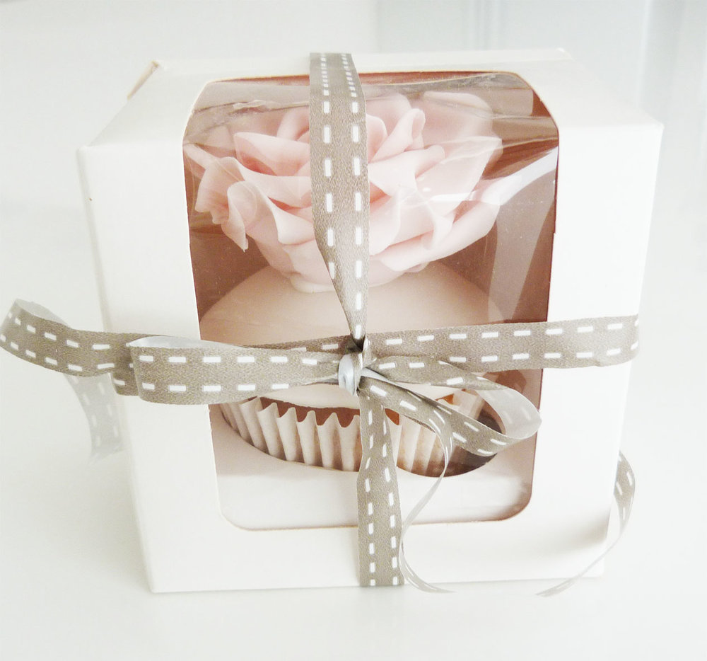 Individually boxed rose cupcake.jpg
