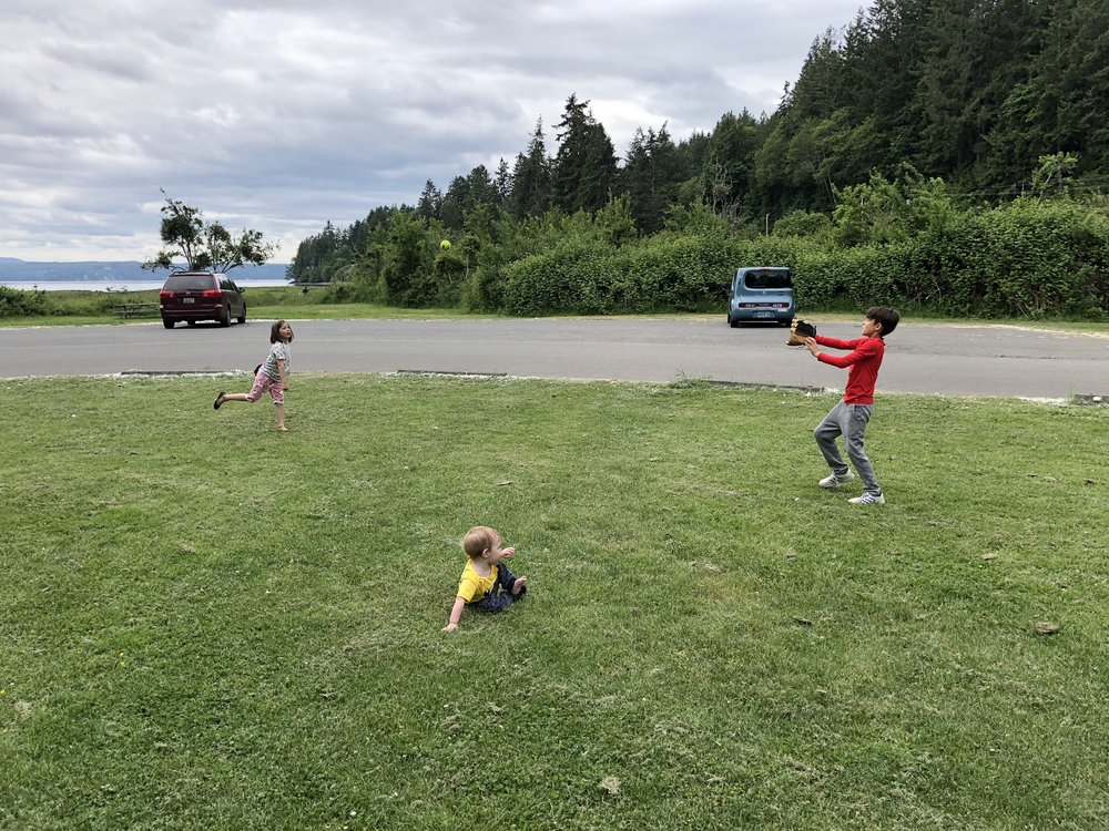 I like to pack a ball and gloves, so the kids can get their wiggles out between destinations.