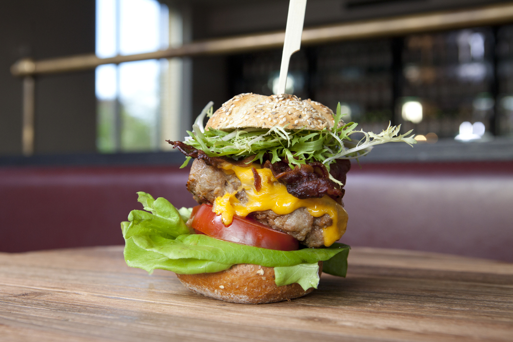 10 Burger side view on wood.jpg