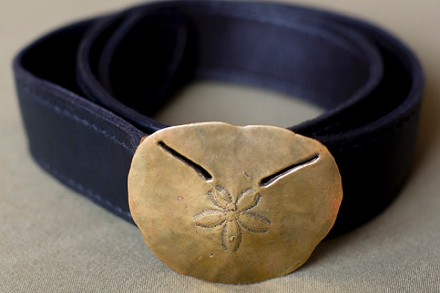 Sand dollar on plain belt. Brass and silver.  Variable sizes.
