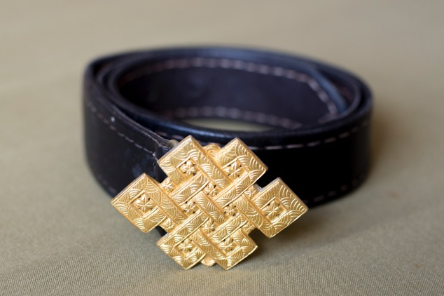 Plain buddhist eternal brass knot.  Variable sizes.