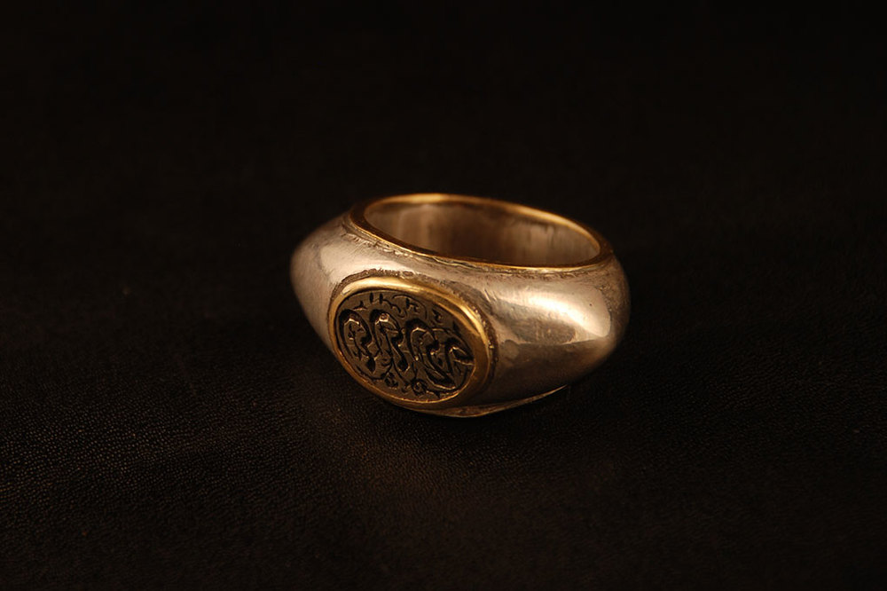 Iranian seal inspired by ancient Roman design, set in silver and gold. Variable sizes.