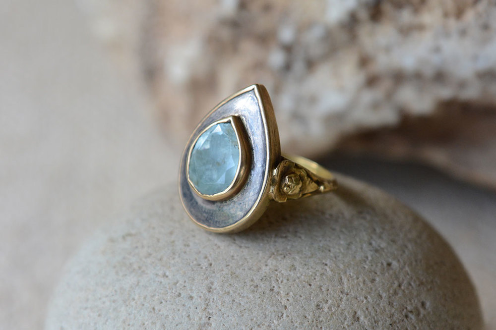 Tear drop faceted aqua marine inspired by ancient Mughal design, set in silver and gold.  Variable sizes.