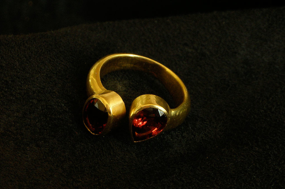 Umbalite Tanzanian garnet set in 22ct gold.  Variable sizes.