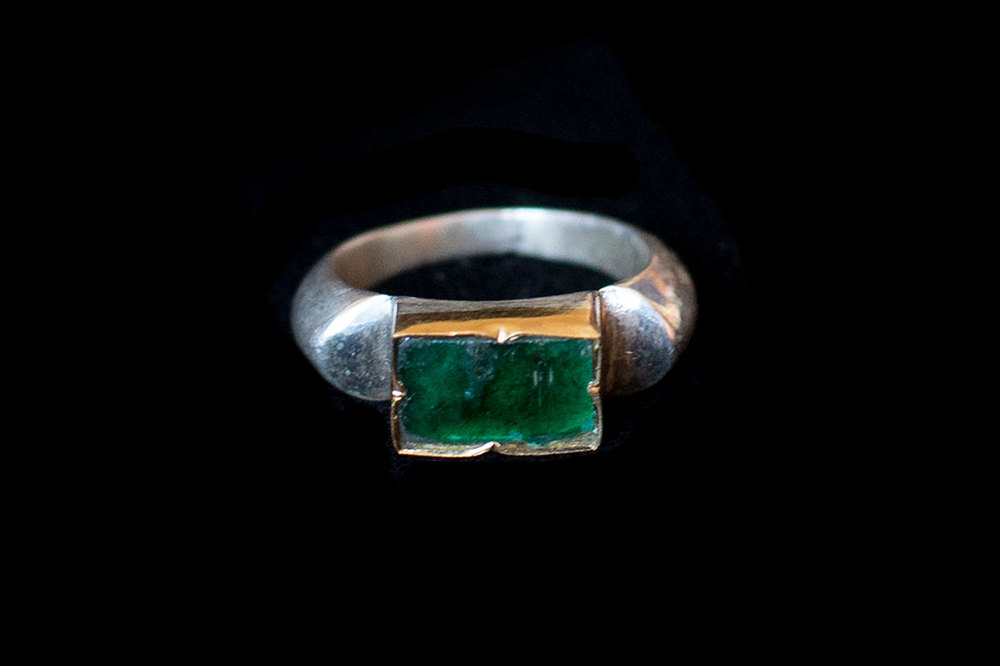 Flat Emerald set in  Roman inspired  style. Silver band and gold bezel. Variable sizes.