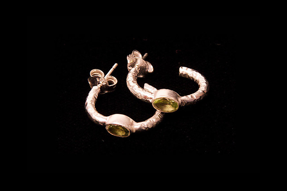 Silver hoops with peridot gemstones. Also available in amethyst, blue topaz. Earring length 2cm, width 2cm.