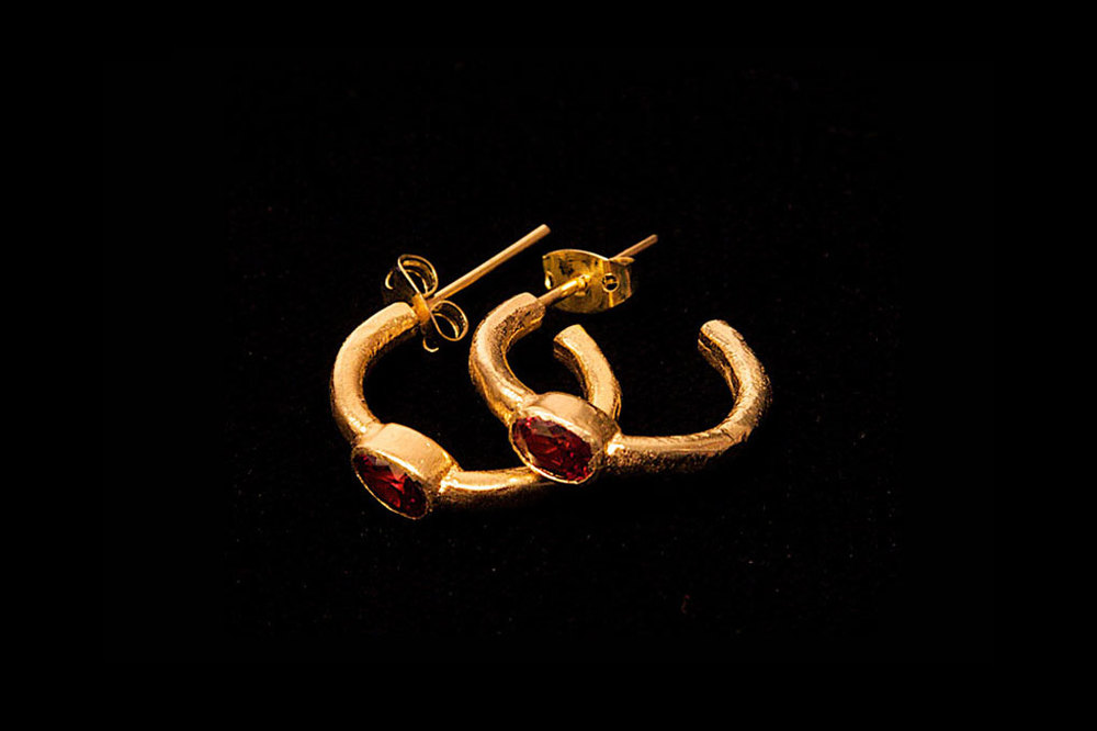 Gold plated silver hoops in red garnet gemstones from Tanzania. Also available in peridot, blue topaz & amethyst. Earring height 2cm- width 2cm.