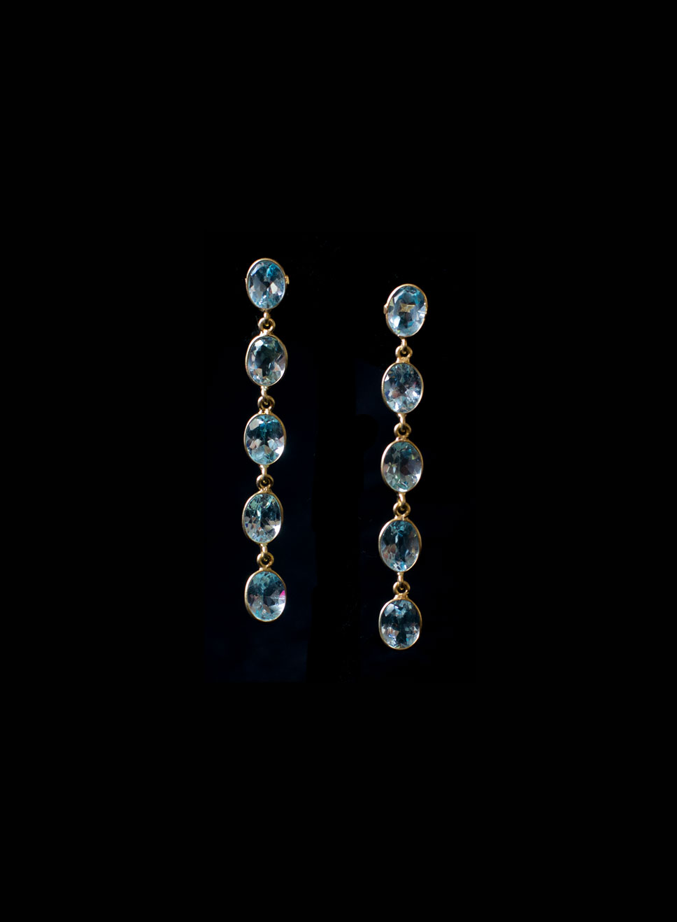 Gold plated silver 5 descending blue topaz drops with bezel. Available in citrine amethyst hessonite garnet. Earring length-6.5cm.