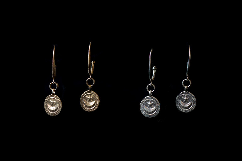 Swahili moon & star disk symbolizing new beginnings with hook. Silver & silver gold plate. Earring length with hook-4.5cm.