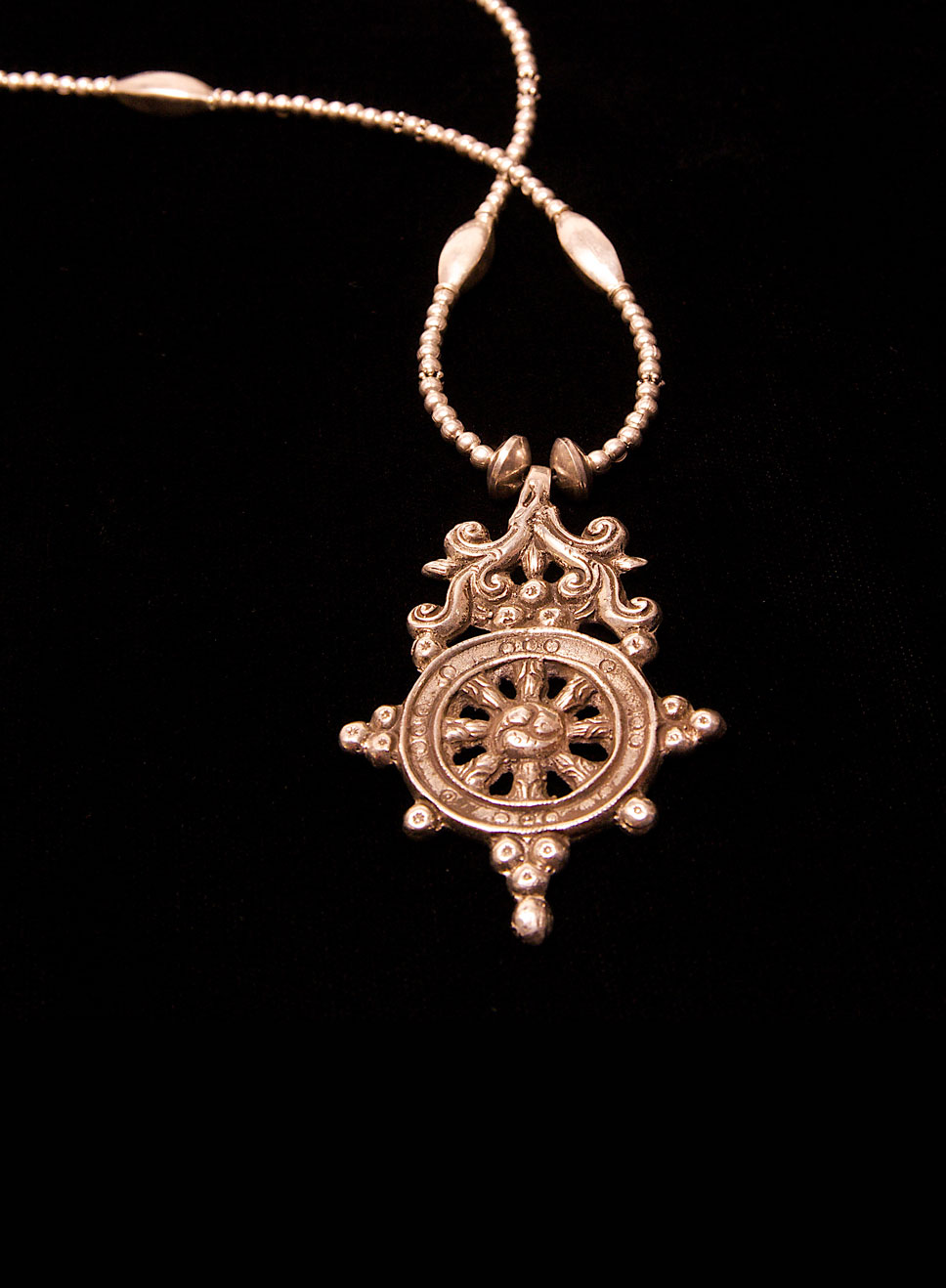 Tibetan wheel of life with a beaded chain. Silver. Length of chain- 93cm. Pendant height- 7cm.  Width- 5cm.