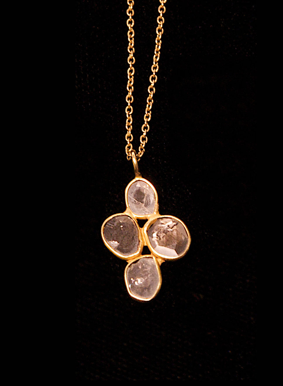 Polki diamond set in 22ct gold with an 18ct gold chain. Length of chain- 45cm. Pendant height- 2.5cm. Width- 2cm.