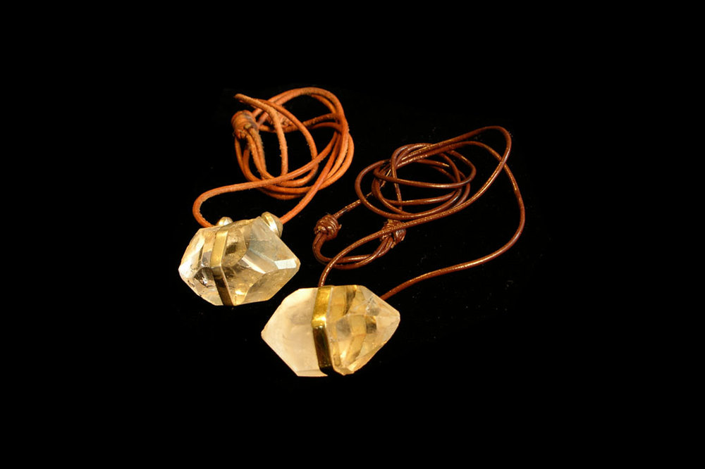 Natural terminated crystals from Kenya wrapped with 18ct gold or silver on an adjustable thong. Varying sizes.