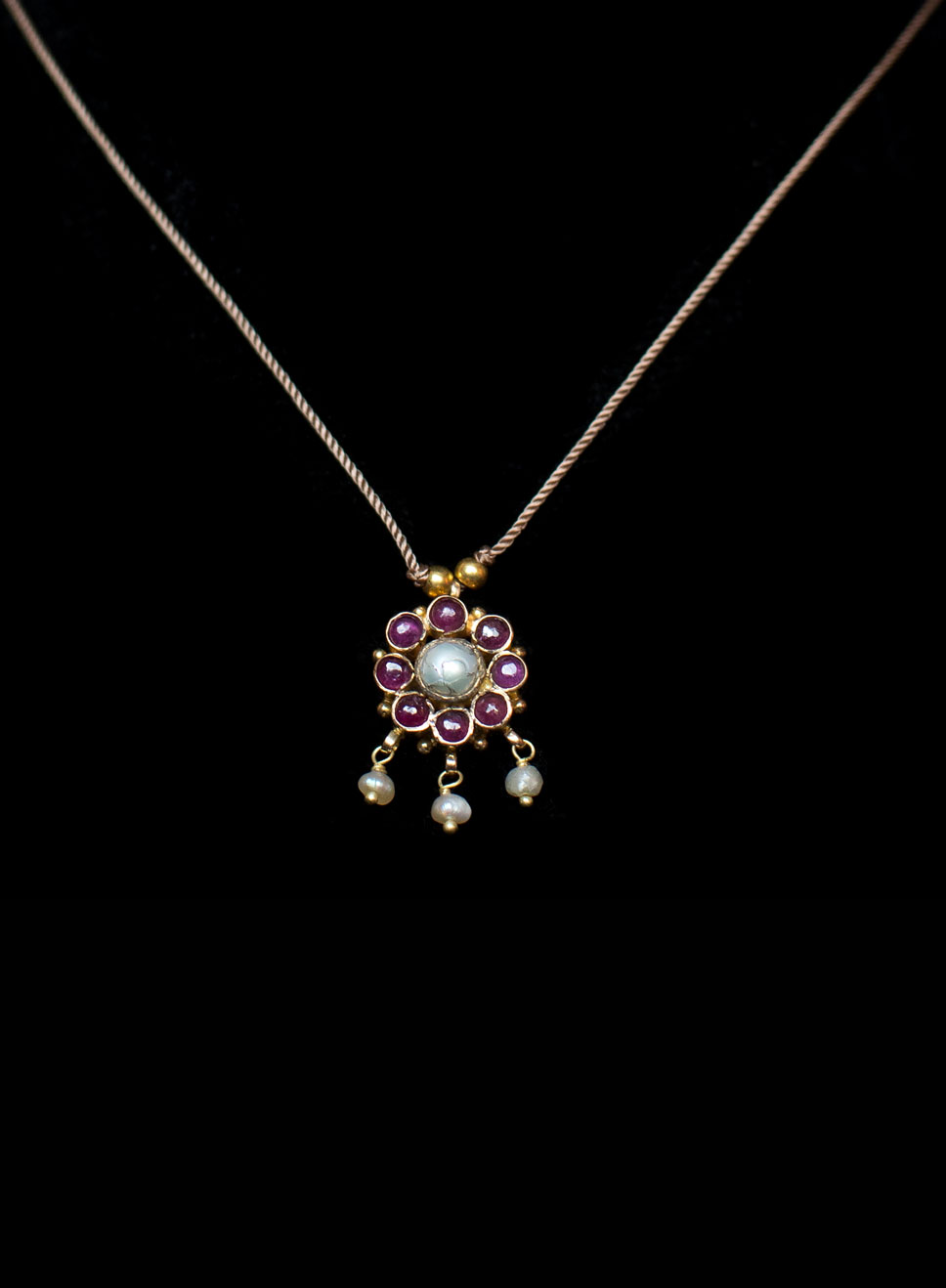Ruby flower pendant pearl drops, 22ct gold with a silk thread. Necklace length- 48cm. Pendant size- 2cm by 2cm.