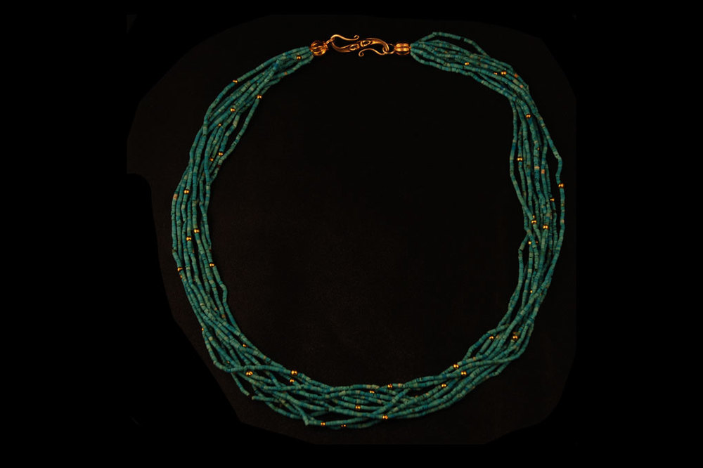 Multi-strand turquoise beads from Afghanistan with 22ct gold beads. Length of necklace- 47cm.