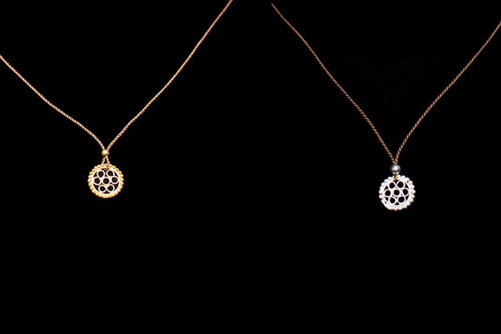 Filigree fertility amulets in silver and 18ct gold. Necklace length- 45cm. Pendant size- 8.5mm by 8.5mm.