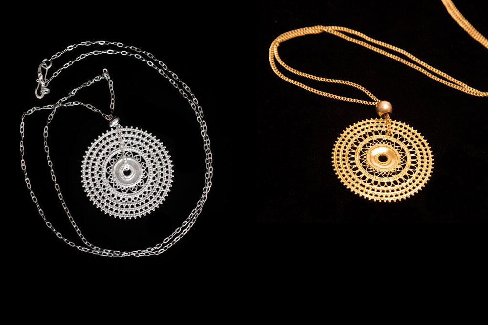 Yemeni fertility wheel and  chain. Available in silver & silver gold plate. Length of chain- 95cm. Pendant height- 6cm. width- 6cm.
